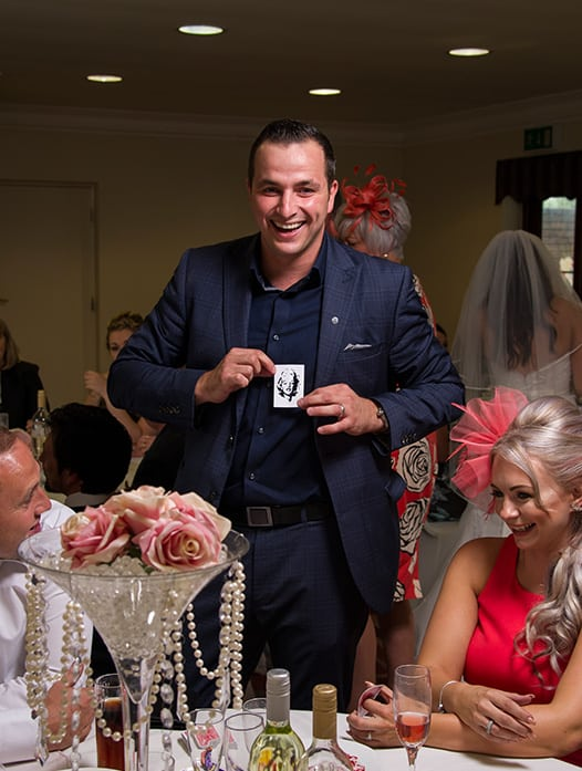 Yorkshire Wedding Magician Jordan O'Grady entertaining guests with close up magic